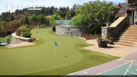 Putting green constructed on artificial turf
