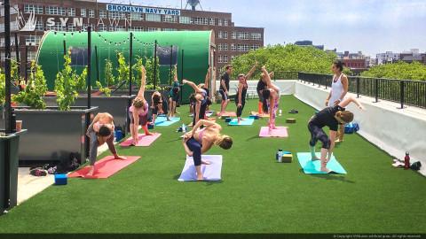 yoga class on artificial turf